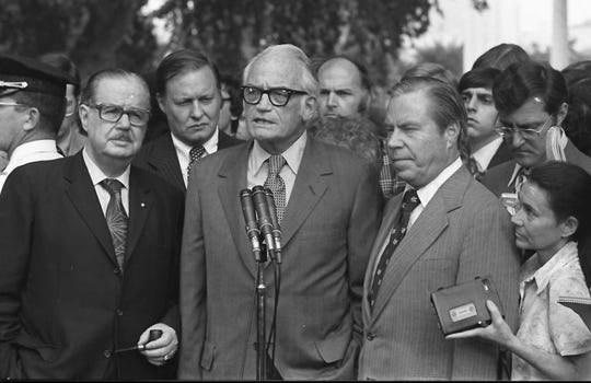 Sen. Barry Goldwater, R-Ariz., speaks to reporters after meeting with President Nixon at the White House Aug. 7, 1974, to discuss Nixon's decision on resigning. Senate Republican leader Hugh Scott is left, and House GOP leader John Rhodes is right.