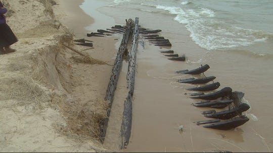 The shipwreck remains that appeared along the Lake Michigan shoreline just south of the White Lake channel, are that of the schooner Contest which was lost in 1882. It's not the L.C. Woodruff, according to the MSRA.