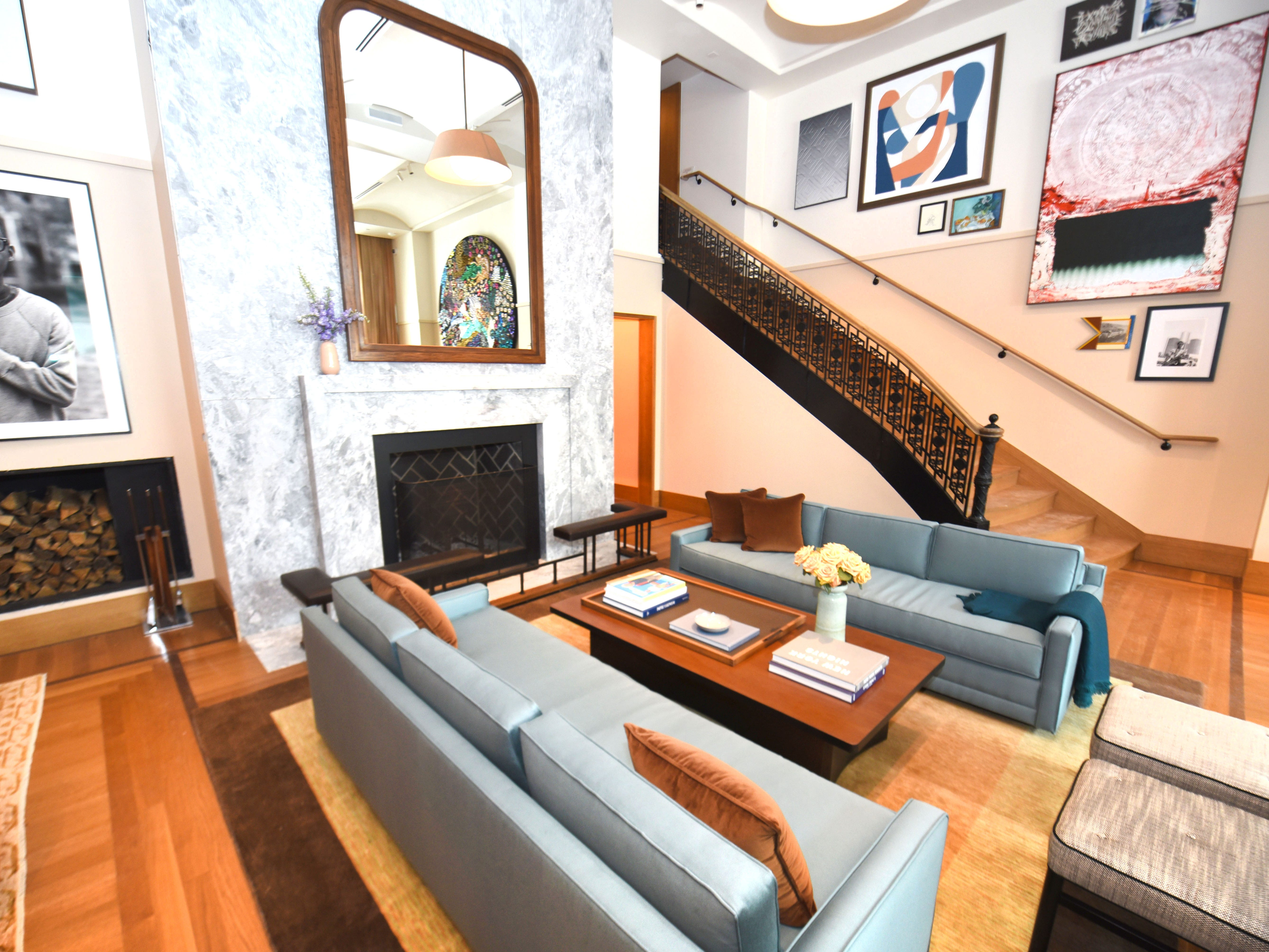 A seating area with a large fireplace is a feature of the main lobby of the Shinola Hotel, which will open January 2, 1019 in downtown Detroit. The space features the building's original staircase.