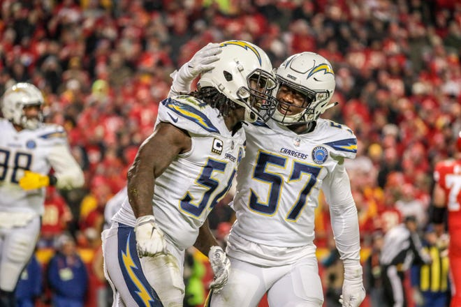 Los Angeles Chargers linebacker Melvin Ingram is congratulated by teammate Jatavis Brown (57) after sacking Kansas City Chiefs quarterback Patrick Mahomes to stop a drive late in the fourth quarter.