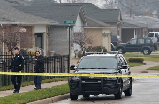An unidentified man talks to a Roseville police officer as he continues his investigation. Roseville police officers investigate the shooting death of a 4-year-old boy at 16415 Dort, between Chalmers and Hudson, in the city, Friday morning, Dec.14, 2018.