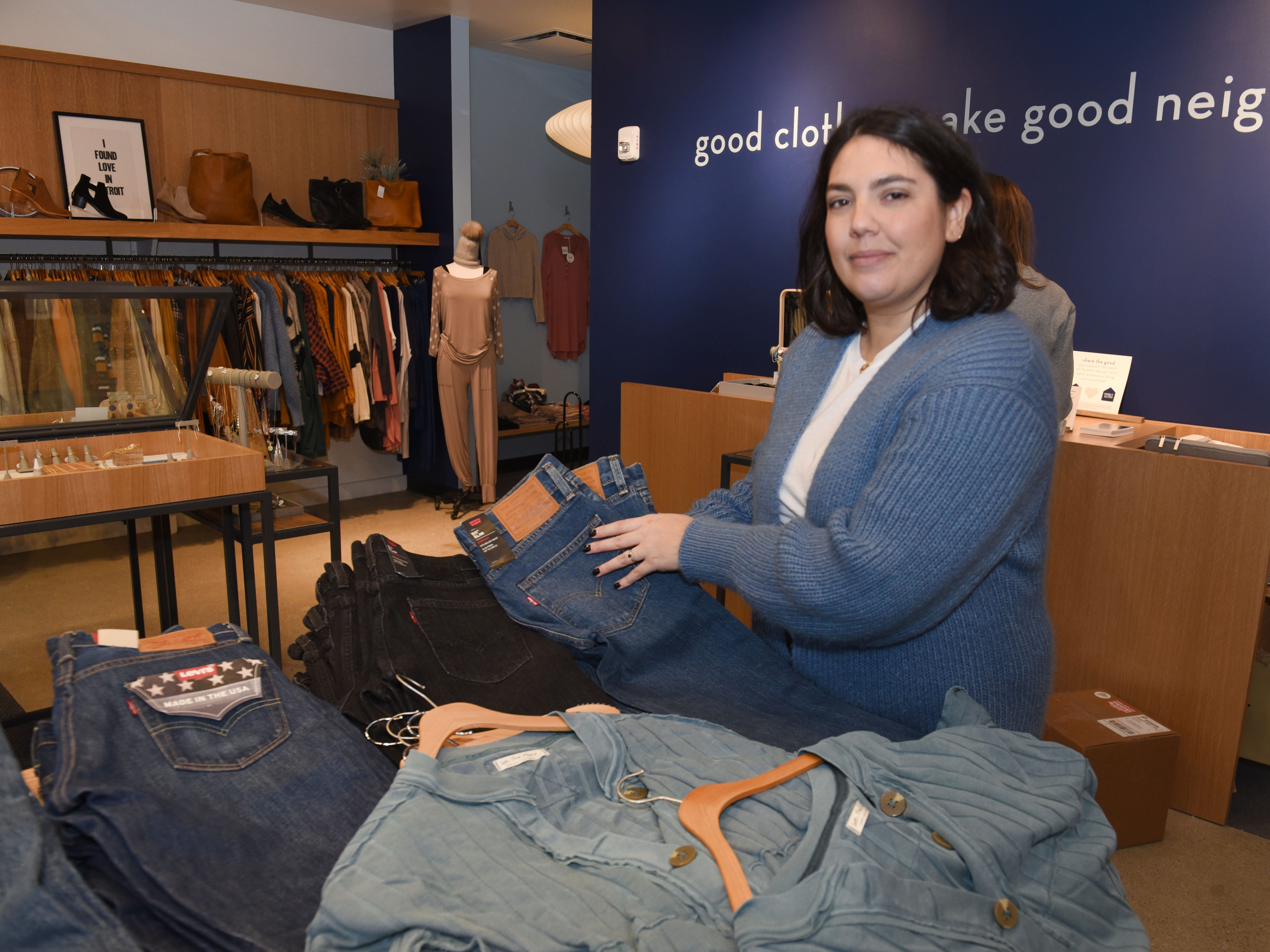 Carli Goltowski, owner of Good Neighbor, works at the newly opened store on  December 7, 2018.