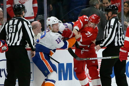 The Red Wings' Dylan Larkin fights the New York Islanders' Josh Bailey on Dec. 8.