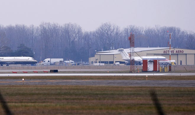 Planes sit on the runway at Willow Run Airport on Friday, December,14, 2018 in Ypsilanti, Michigan.