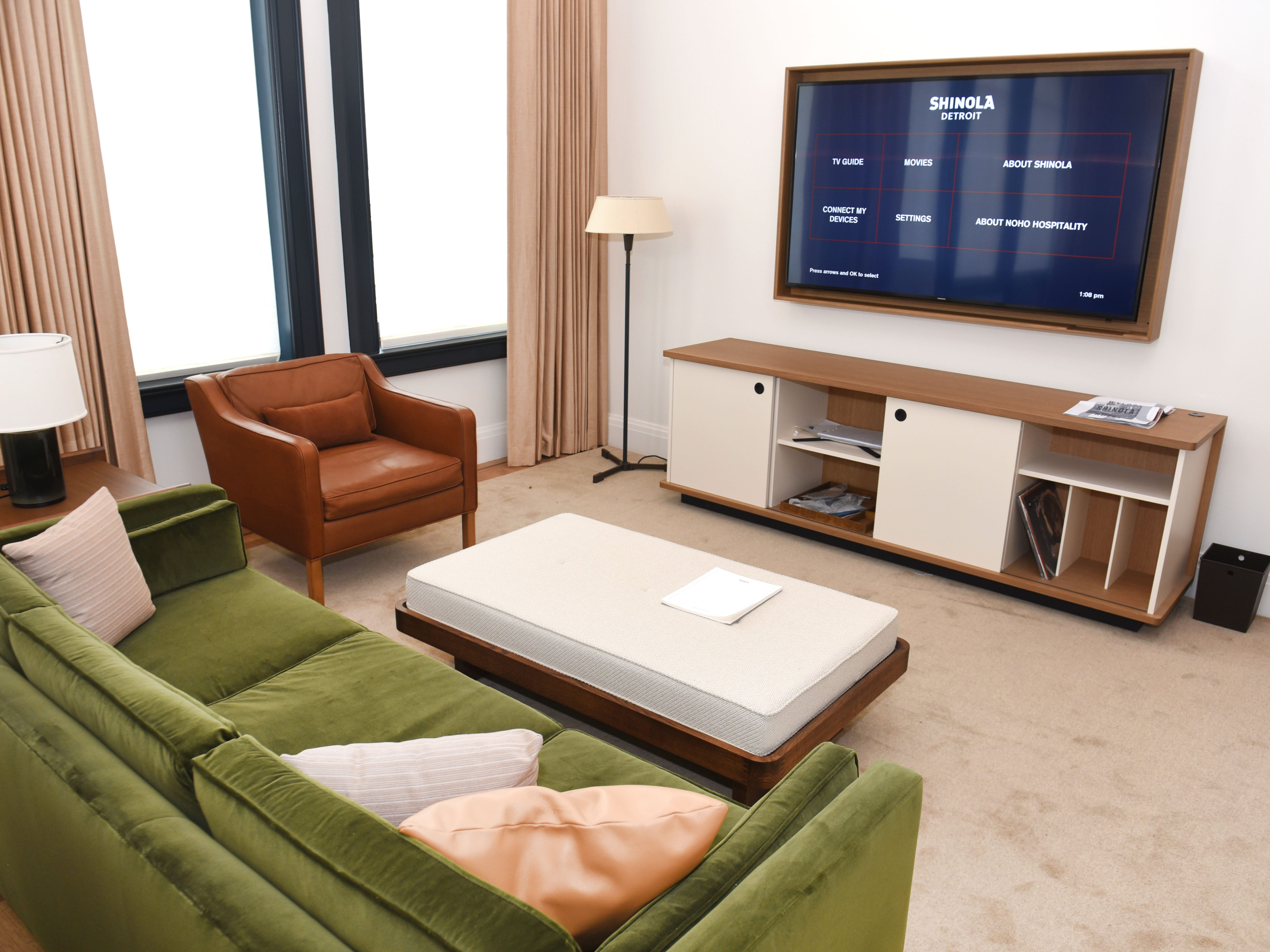 This guest suite includes a large television mounted on the wall.