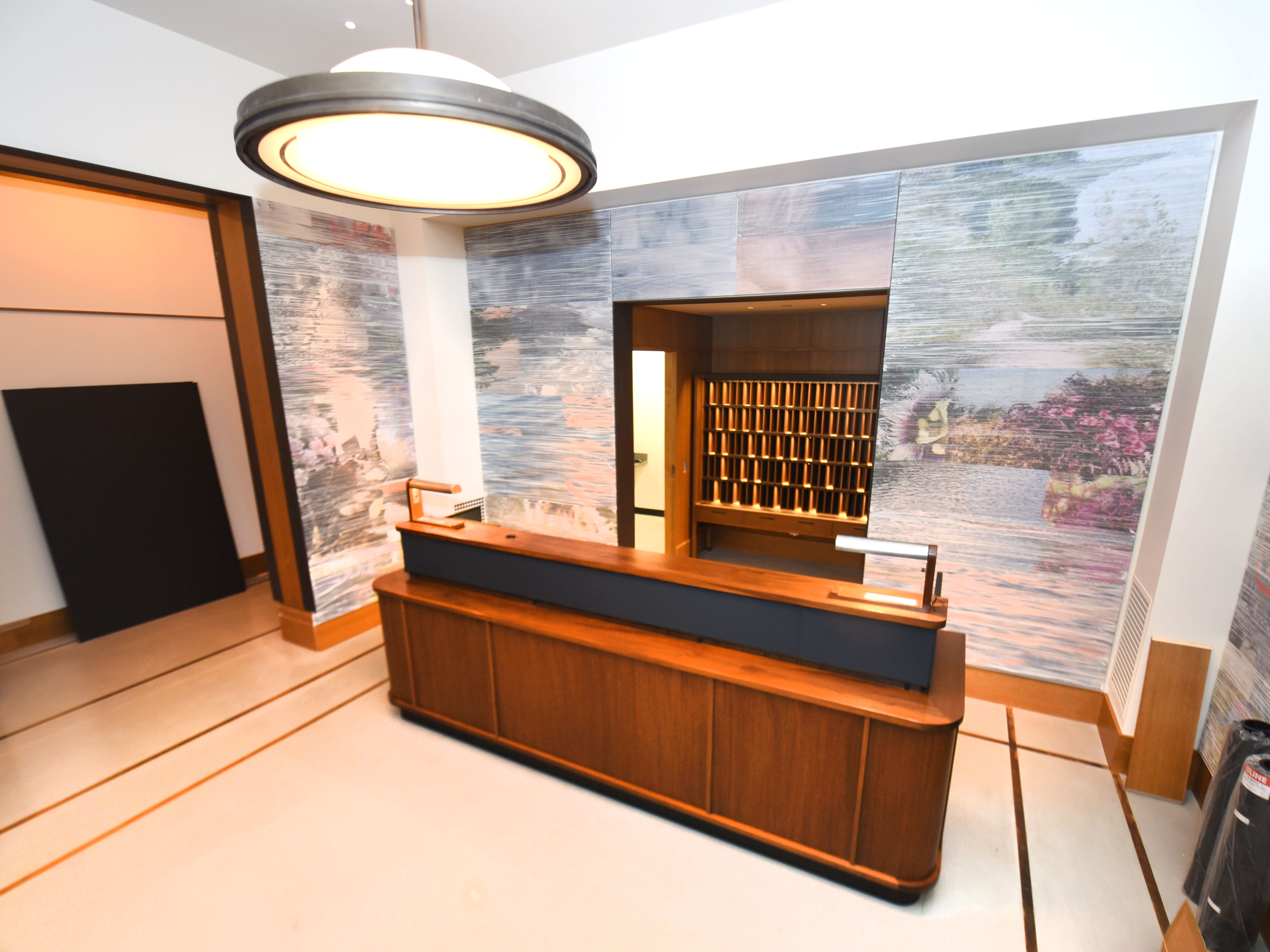 Guests will check in here, at the hotel's reception desk.