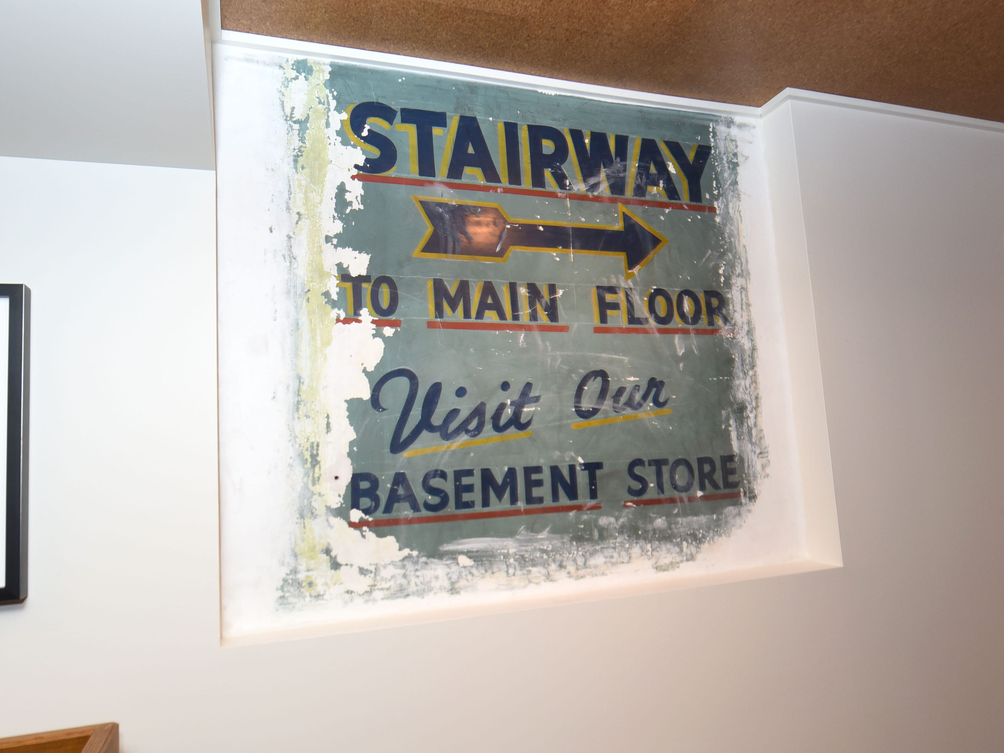 Vintage signage is seen in an upstairs lounge and guest reception area.