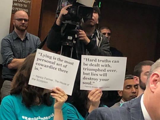 Michigan State University trustees and officials faced renewed protests and criticism from victims of sex abuser Larry Nassar and their supporters during a meeting Friday, Dec. 14, 2018.