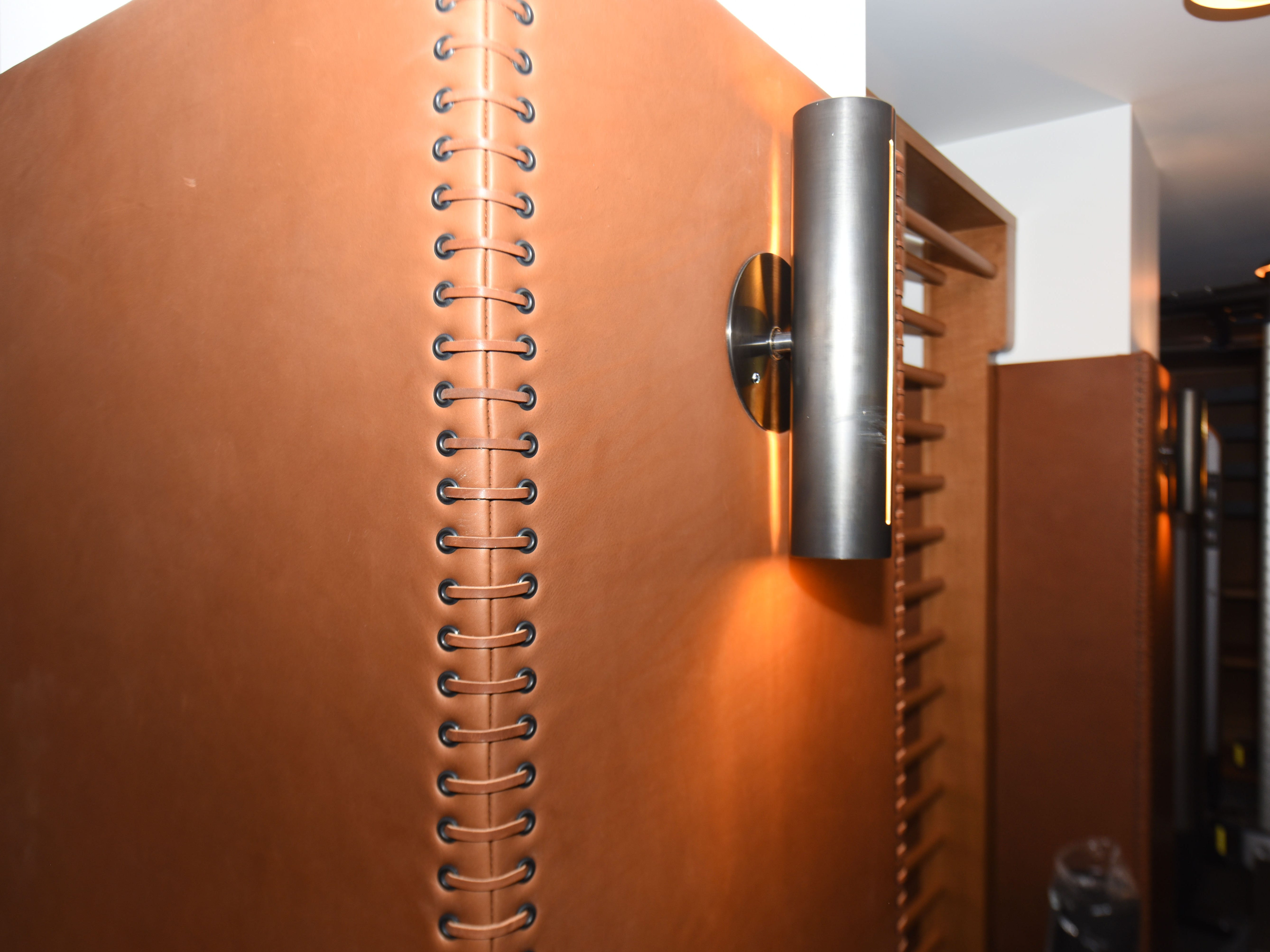 Leather covering and stitching cushion the pillars in the exercise and fitness center.