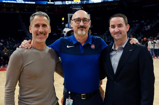 Pistons trainers, from left, Arnie Kander, Bernard Condevaux and Jim Scholler pose for a photo before a game at Little Caesars Arena last month.