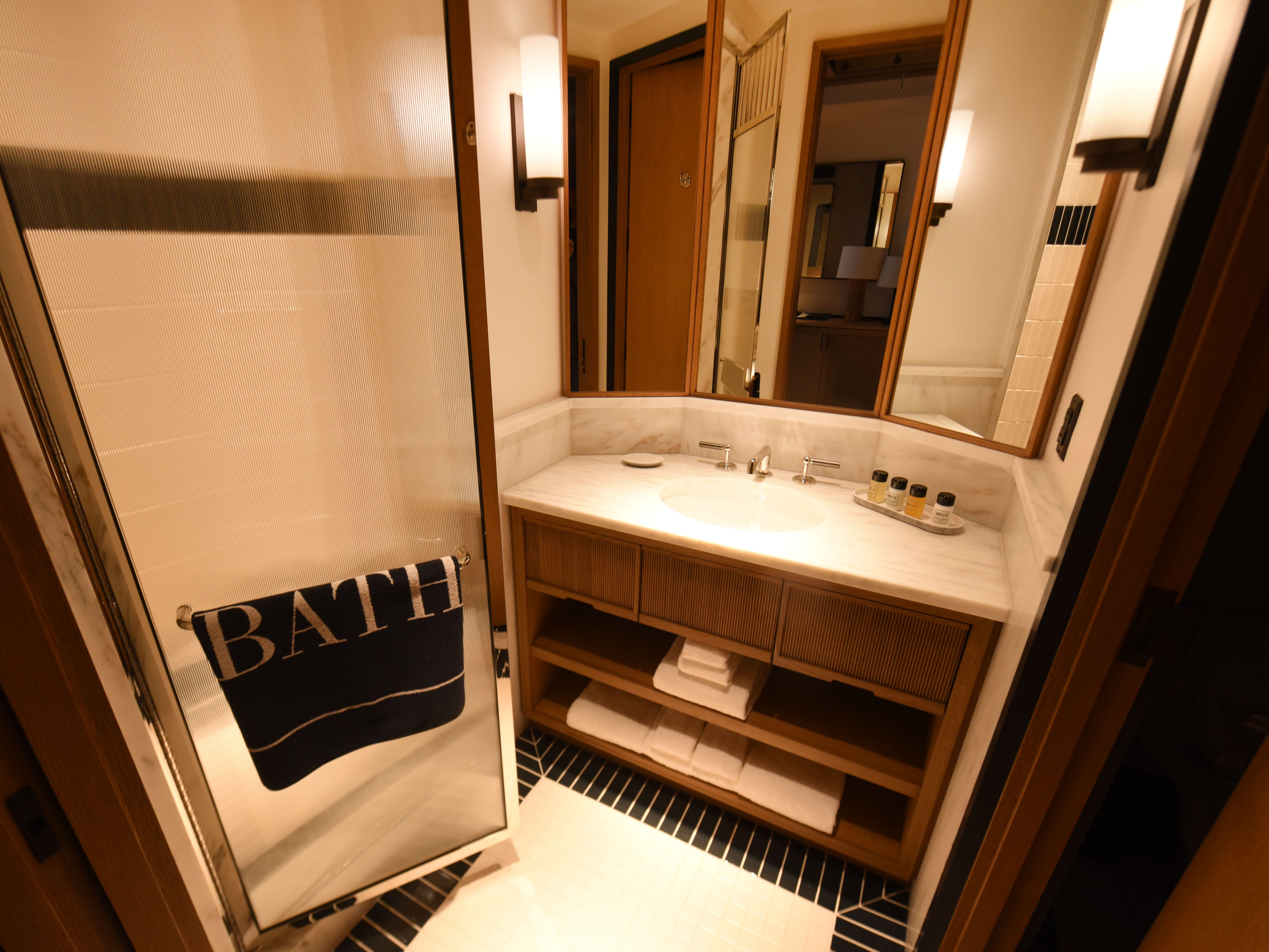 The custom vanity and shower inside a guest room.