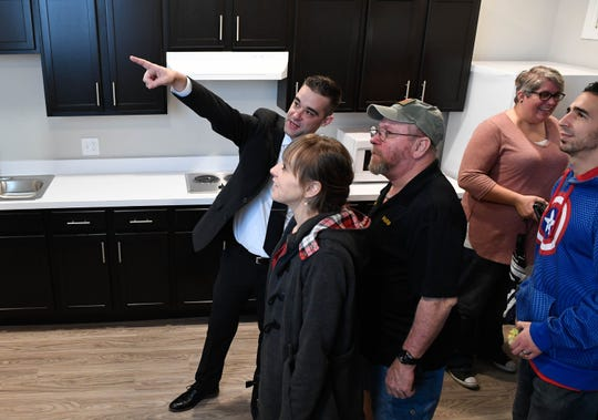 ECHO Housing Corp. executive director Chris Metz leads a tour of one of the housing units at the opening of the Garvin Lofts housing facility for people experiencing chronic homelessness Friday, December 14, 2018.