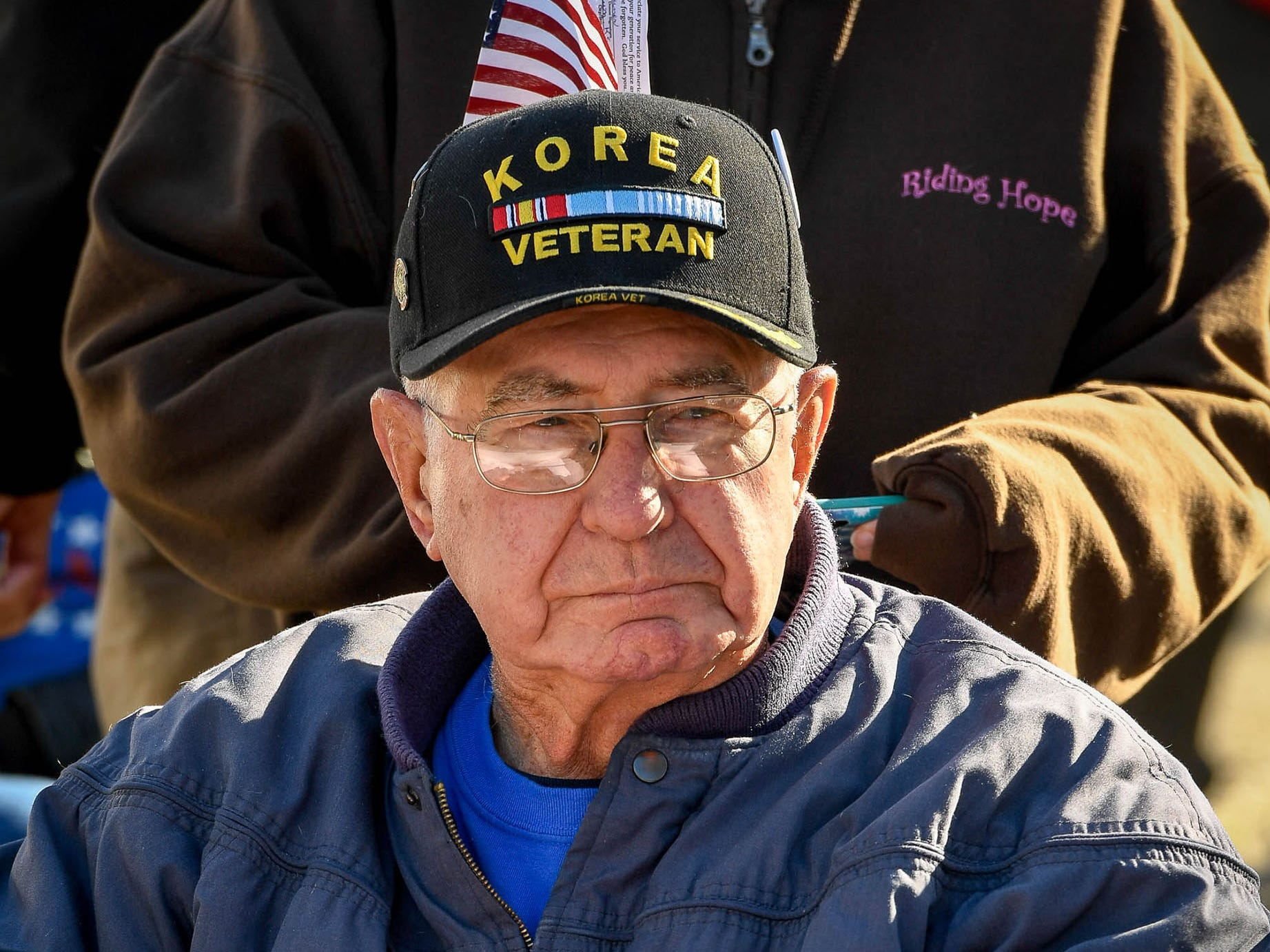 Marvin Lawrence Zwahlen, a Korean War veteran, waits for the start of the annual Four Freedoms Veterans Parade on Evansville's West Franklin Street, Saturday, Nov. 10, 2018.