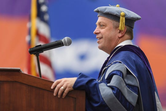 President Christopher Pietruszkiewicz addresses the crowd during the University of Evansville's winter commencement ceremony held at Meeks Family Fieldhouse inside UE's Carson Center in Evansville, Ind., Thursday, Dec. 13, 2018.