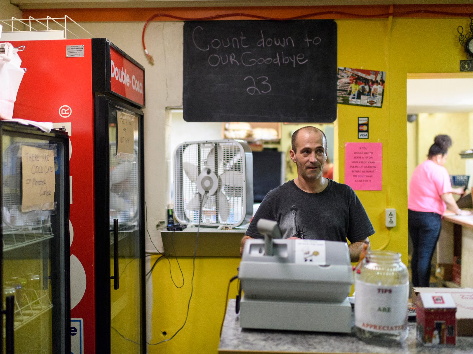 Ed Roach works the cash register as customers pick up carry out orders at Stan's Una Pizza, located on Evansville's west side, Friday night, Dec. 7, 2018. His parents are retiring from the pizza business after owning Stan's for over 17 years.