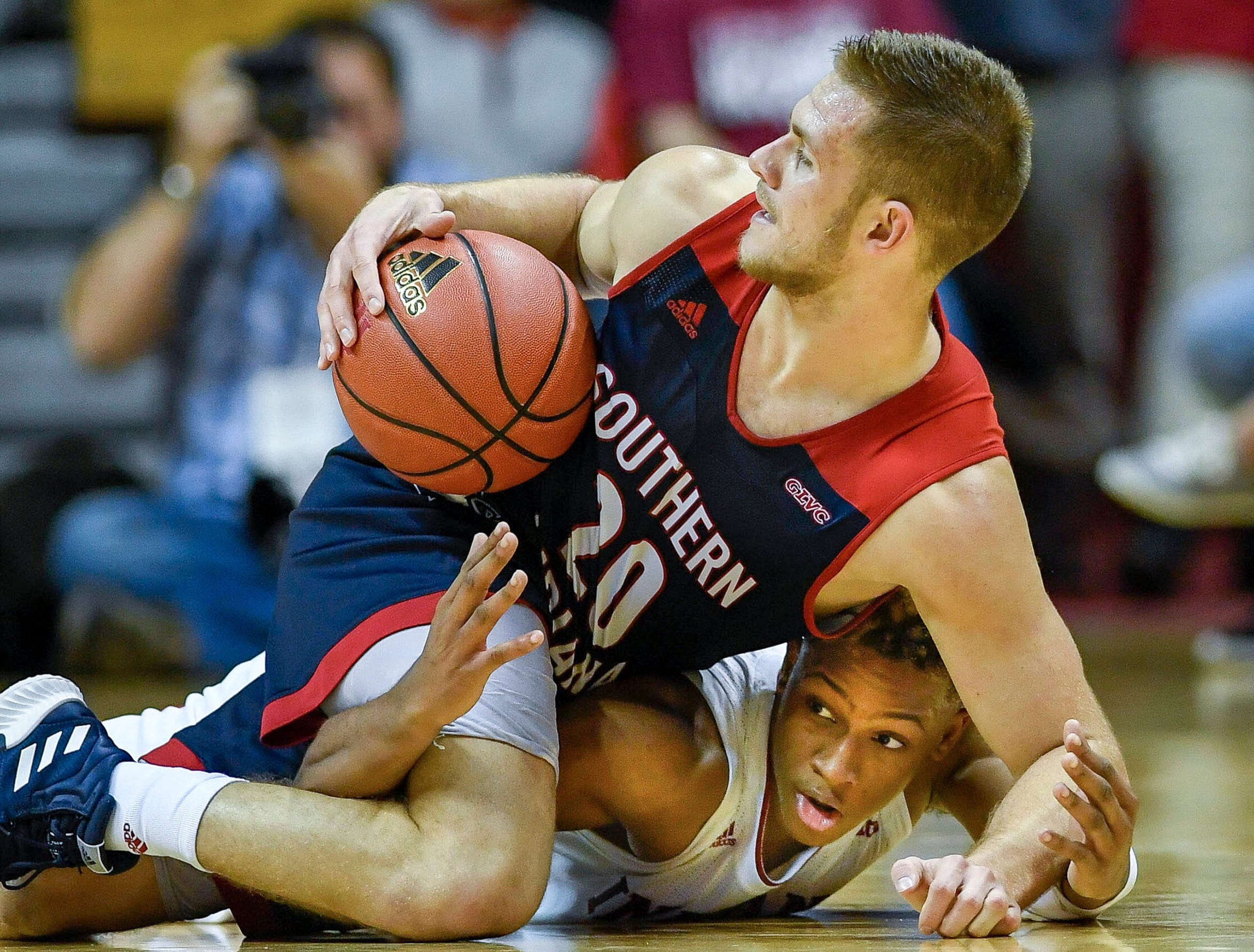 University of Southern Indiana's Alex Stein (20) scrambles on the floor with Indiana's Romeo Langford (0) as the University of Southern Indiana Screaming Eagles take on the Hoosiers of Indiana University in an exhibition game at Assembly Hall in Bloomington, Thursday, November 1, 2018.