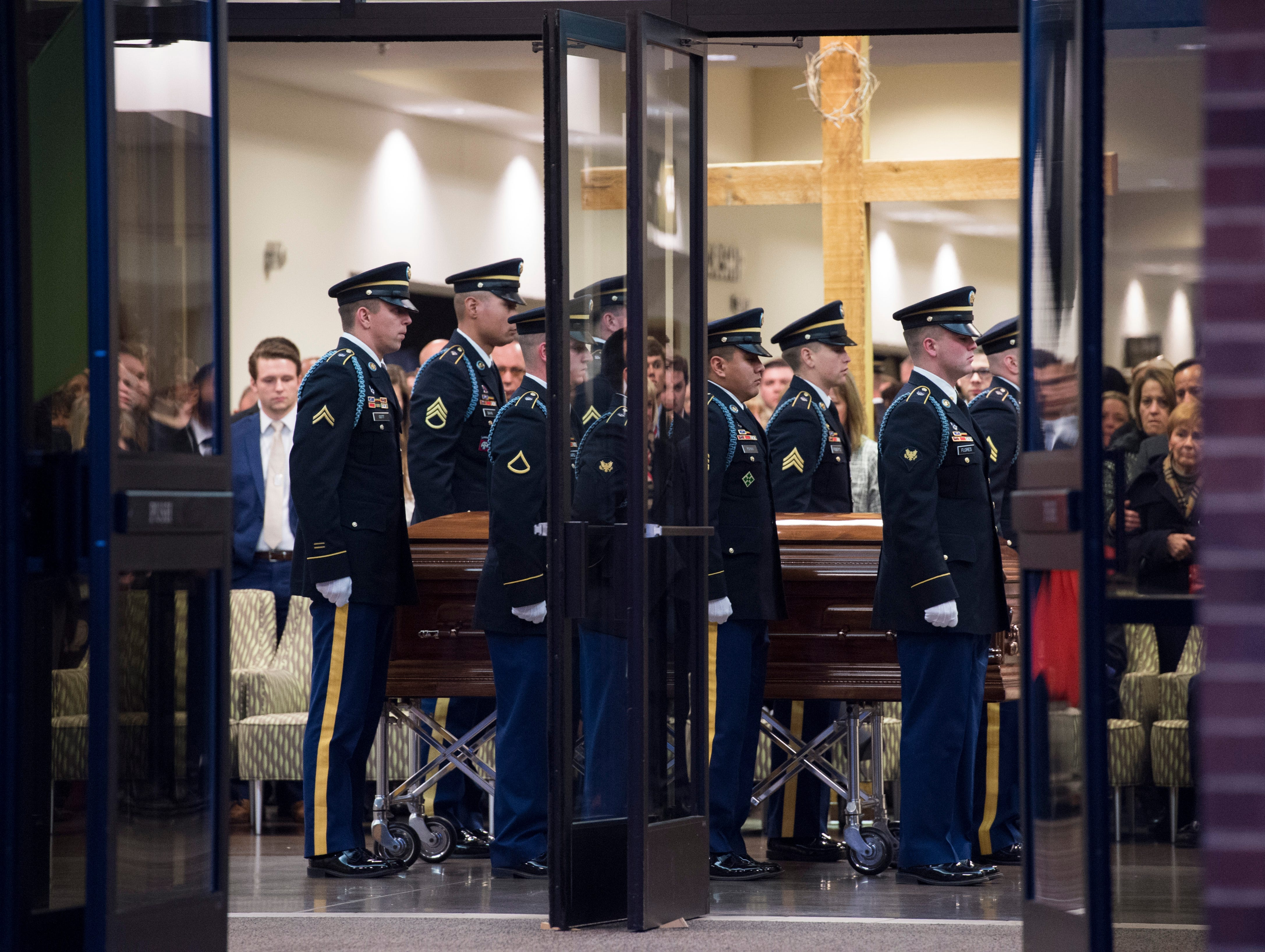 "Fellow soldiers stand next to the casket of Sgt. Drew Watters in the lobby of Christian Fellowship Church during a ""Celebration of Life"" ceremony in Evansville, Ind., Wednesday afternoon, Nov. 14, 2018. The 23-year-old Evansville native was killed in a training accident at his Tacoma, Washington, base."