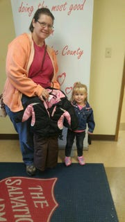 2-year-old Grace Klapperich outgrew her snowsuit and brought her mom, Brenda Klapperich, to the Salvation Army to donate it.