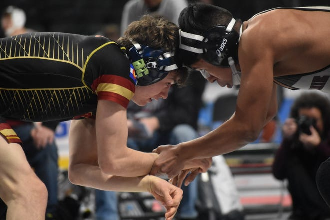 Windsor's Will Vombaur, left, wrestles Laramie's Jose Rodriguez in the second round of the 126-pound division on Friday at the Northern Colorado Christmas Classic wrestling tournament at Budweiser Events Center. Vombaur won by pin.