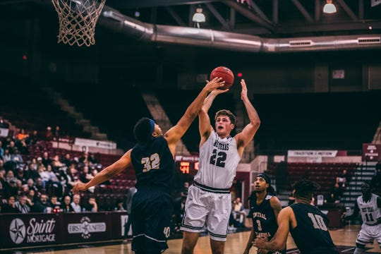 West Texas State senior Ryan Quaid goes up for a shot during a recent game. Quaid has added 35 pounds of muscle since leaving The former Fossil Ridge High School four years ago.