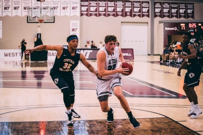 West Texas State senior Ryan Quaid drives to the basket during a recent game. The former Fossil Ridge star has grown into a leader for the Buffs.