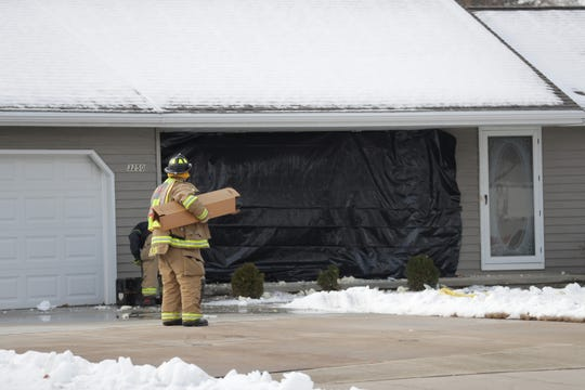 Bellevue firefighters work at 3250 Meadow Circle, one of two homes damaged when a driver lost control of her car. A driver at 3242 Meadow Circle destroyed the back wall of their garage, panic reversed out of the garage into the street down to doors and through the front of 3250 Meadow Circle.