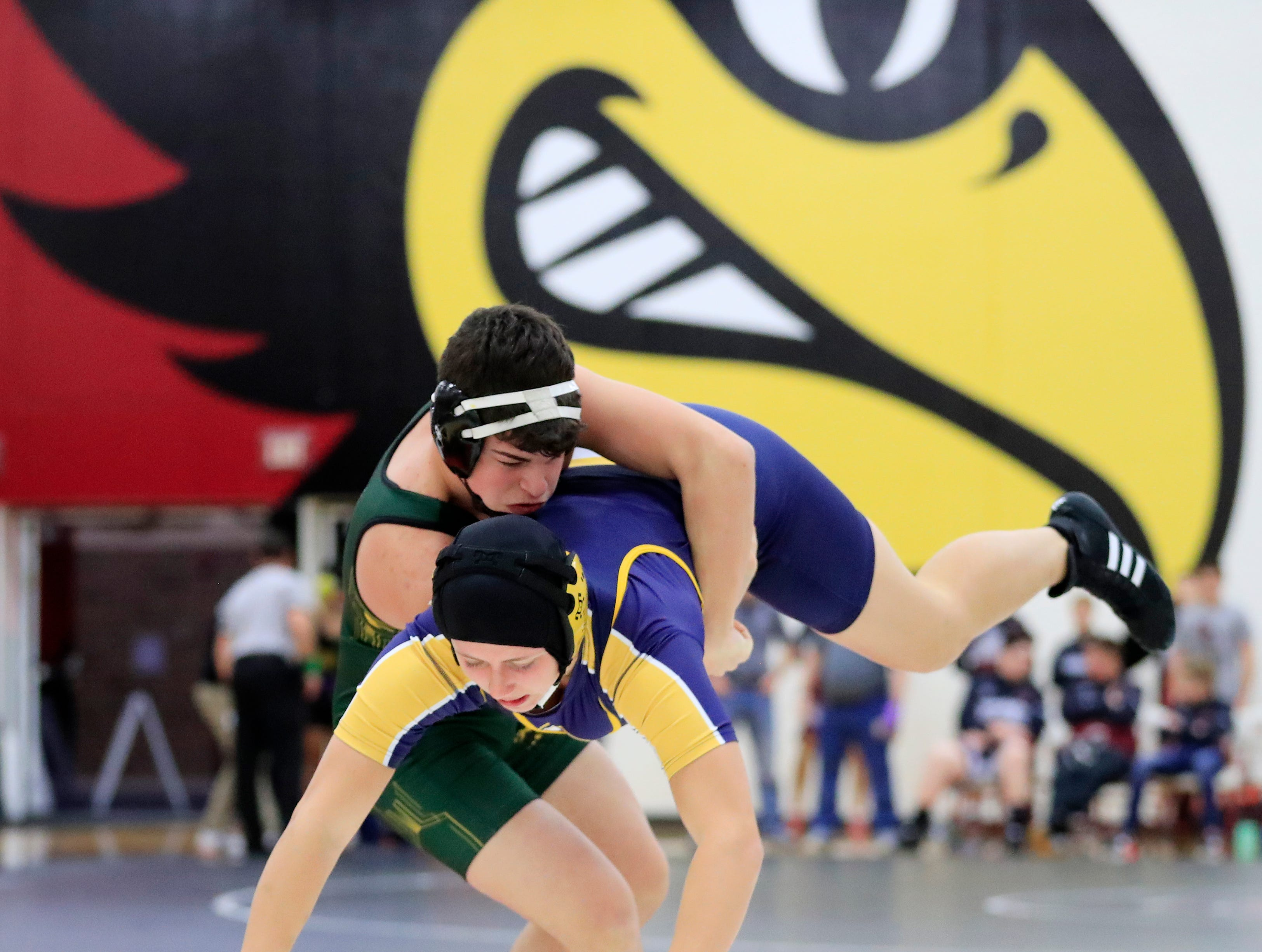 Green Bay Preble's Devin LaPlante takes down Sheboygan North's Emily Kramp in a 170-pound bout at De Pere high school on Thursday, December 13, 2018 in De Pere, Wis.