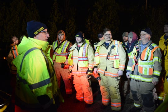 First responders listen to search directions near Door County Q and Birch Road, Baileys Harbor, before looking for missing man, 76.