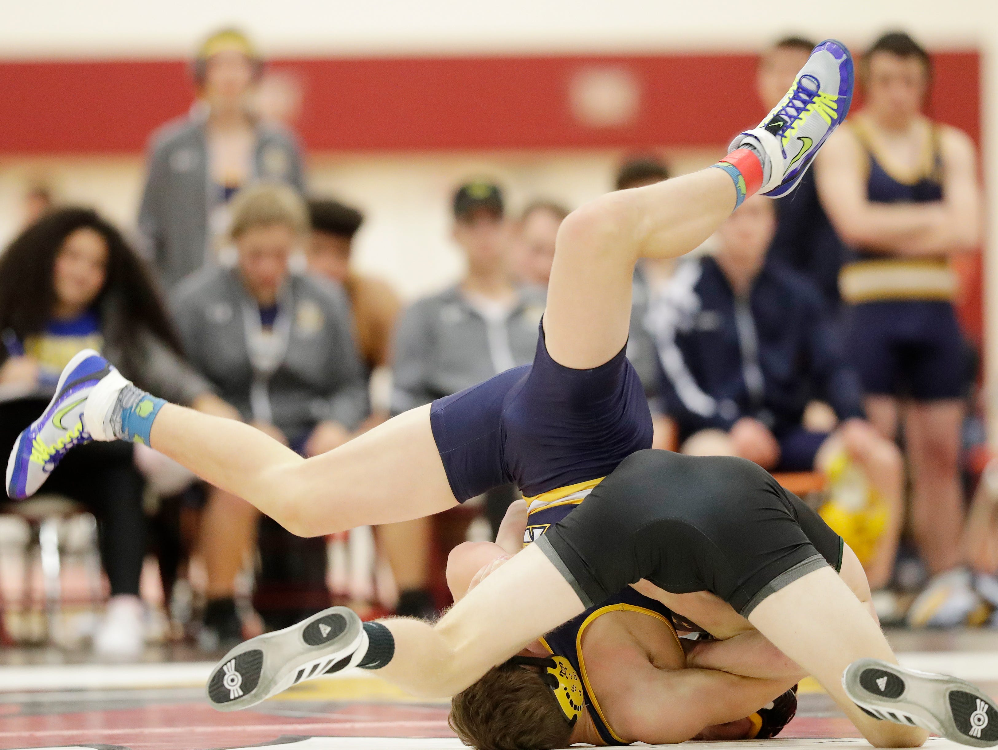 Ashwaubenon and Sheboygan North wrestlers compete in a 152-pound bout at De Pere high school on Thursday, December 13, 2018 in De Pere, Wis.