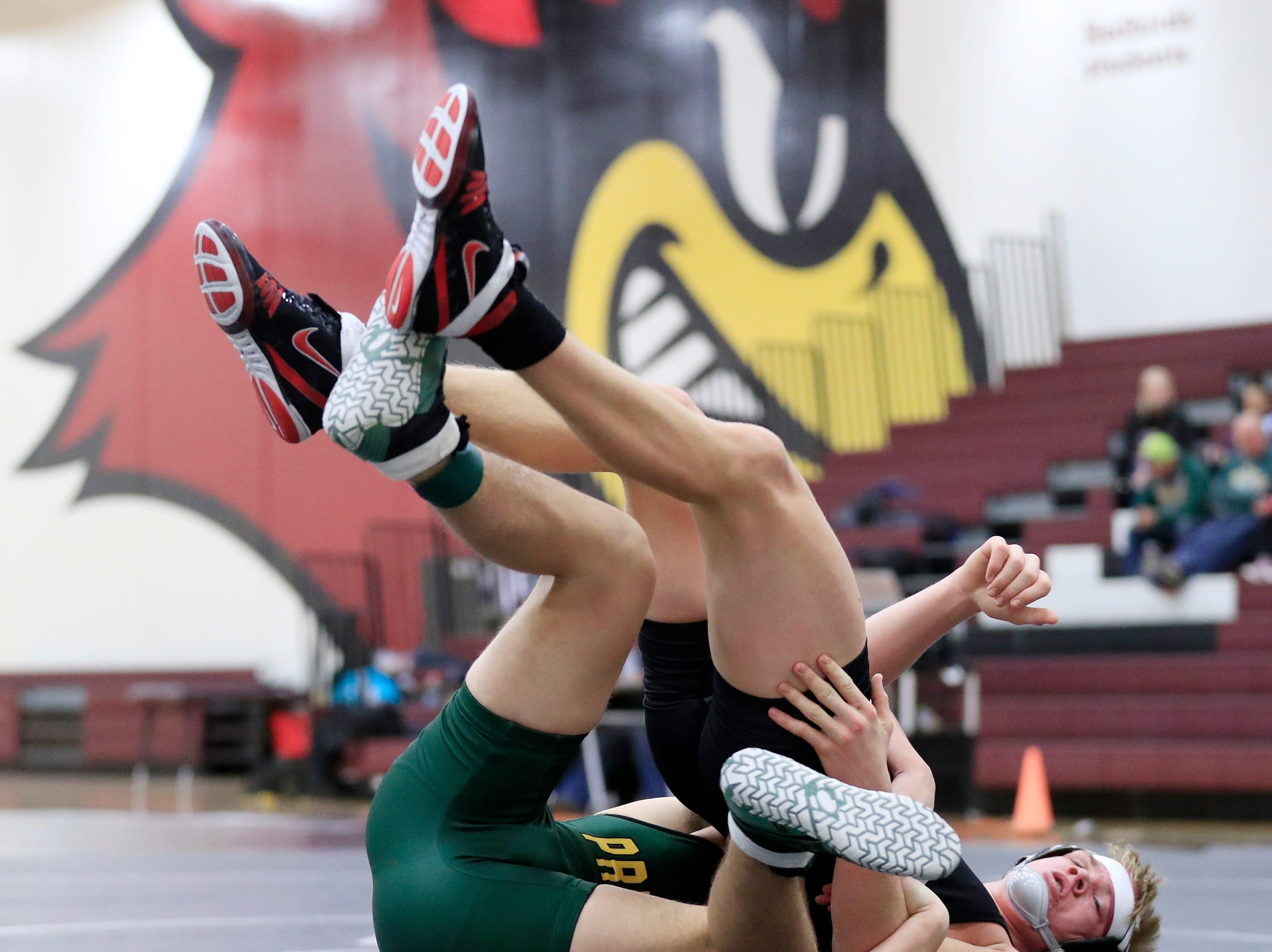 De Pere's Hayden Kincade wrestles Green Bay Preble's Devin LaPlante in a 170-pound bout at De Pere high school on Thursday, December 13, 2018 in De Pere, Wis.