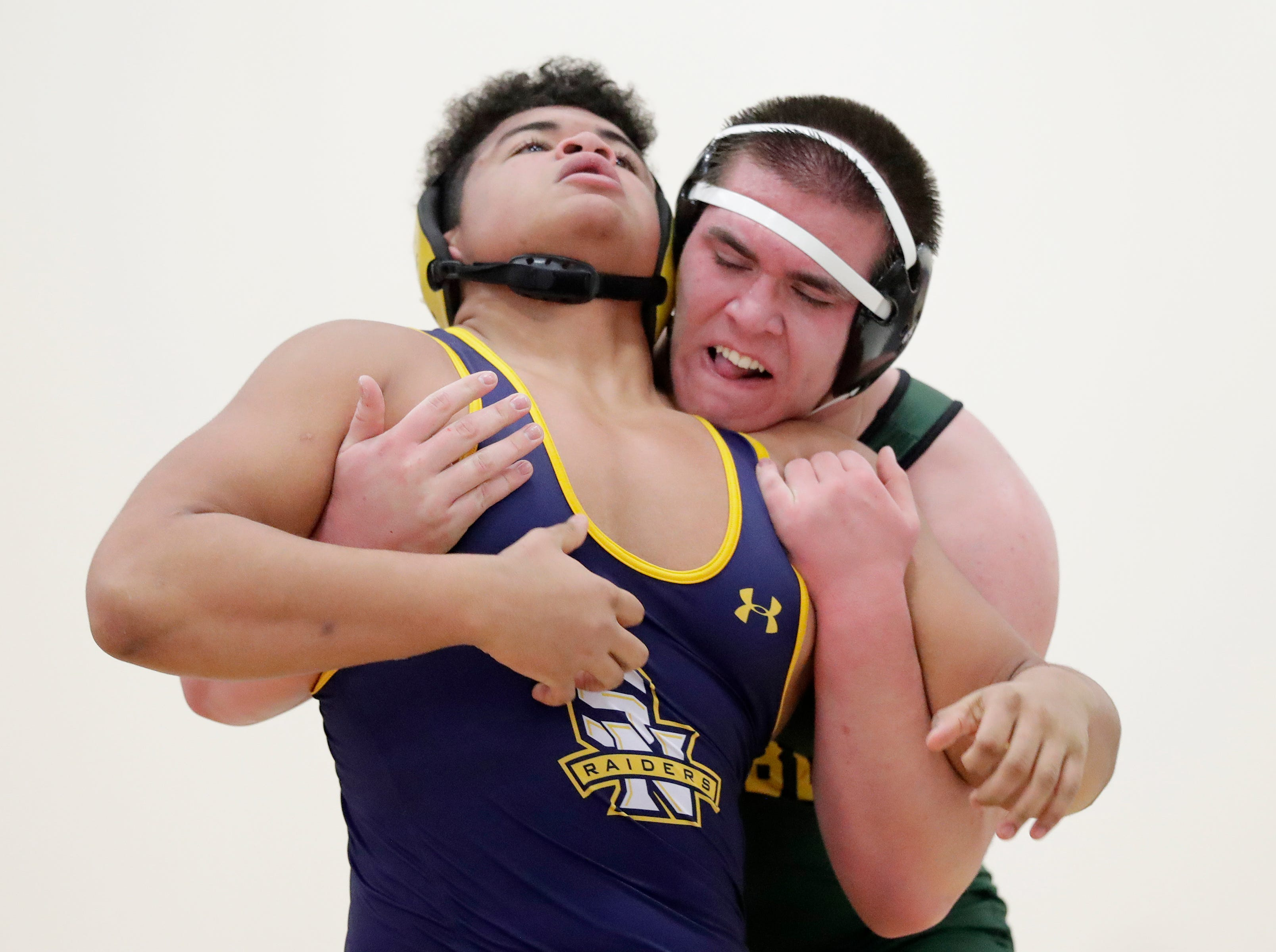Green Bay Preble's Jakob Wolfe wrestles Sheboygan North's Cassius Rohadfox in a 285-pound bout at De Pere high school on Thursday, December 13, 2018 in De Pere, Wis.