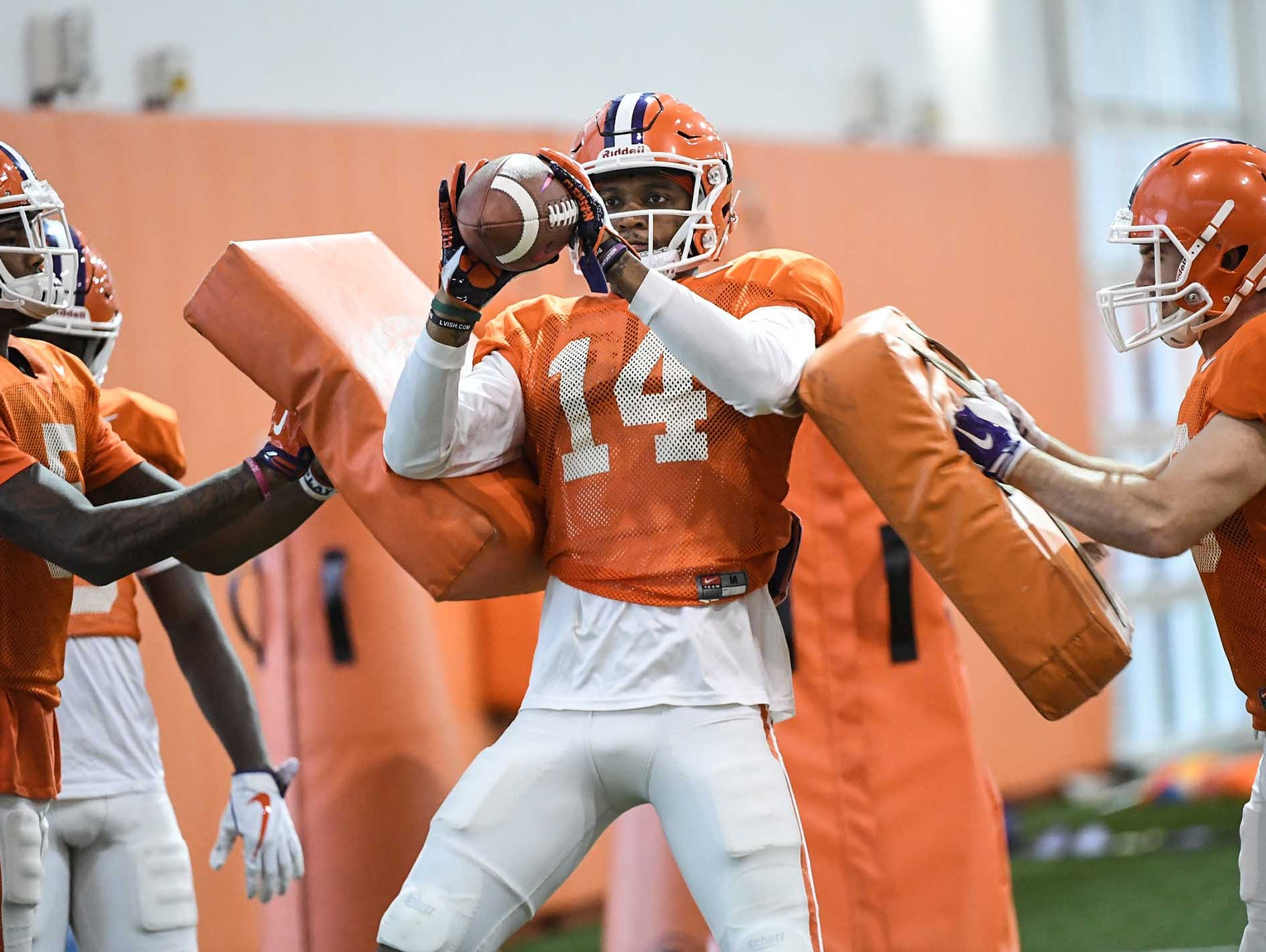 Clemson wide receiver Diondre Overton (14) catches a pass during practice for the Cotton Bowl at the Poe Indoor Facility in Clemson Friday, December 14, 2018.