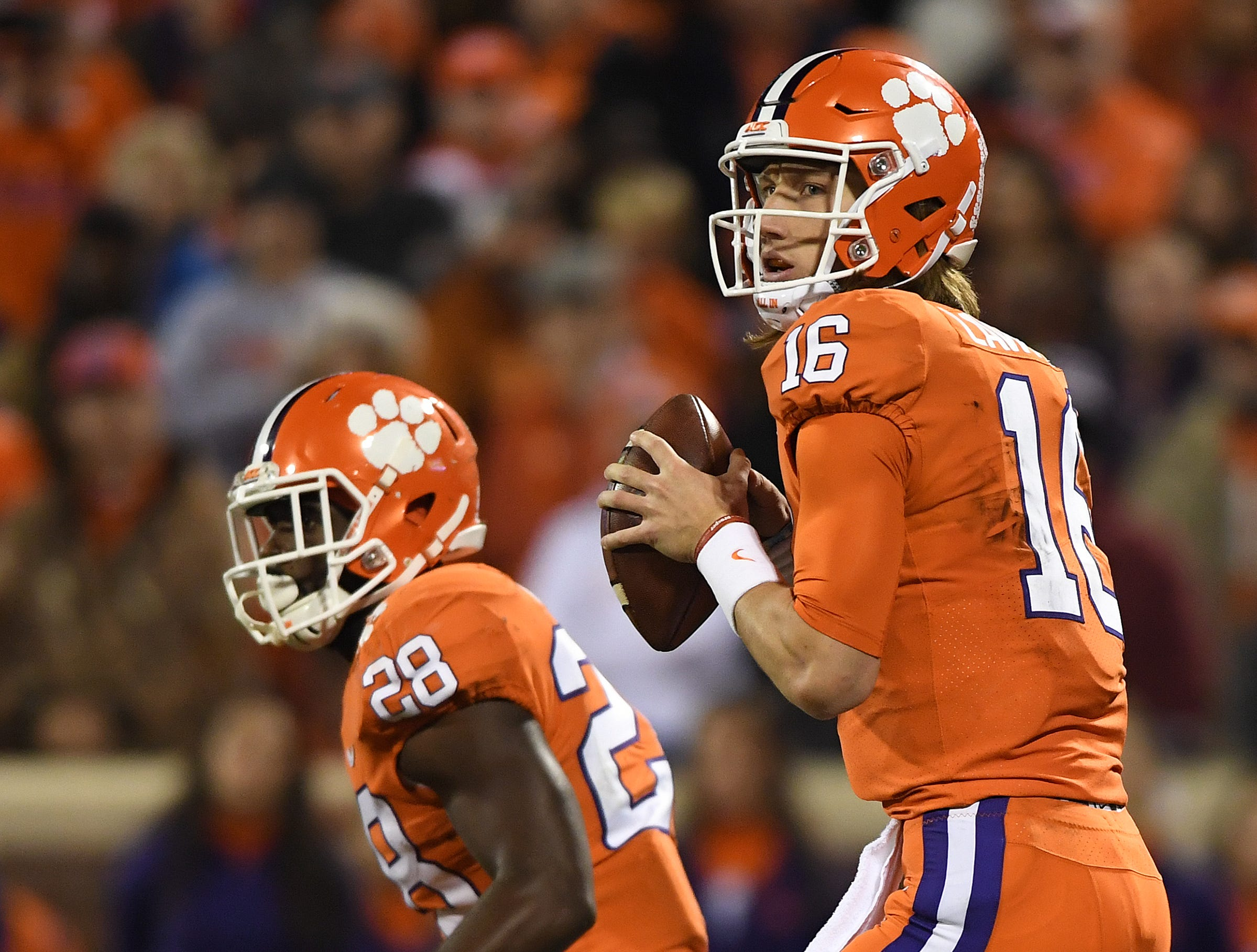 Clemson quarterback Trevor Lawrence (16) looks to pass against South Carolina during the 2nd quarter Saturday, November 24, 2018 at Clemson's Memorial Stadium.