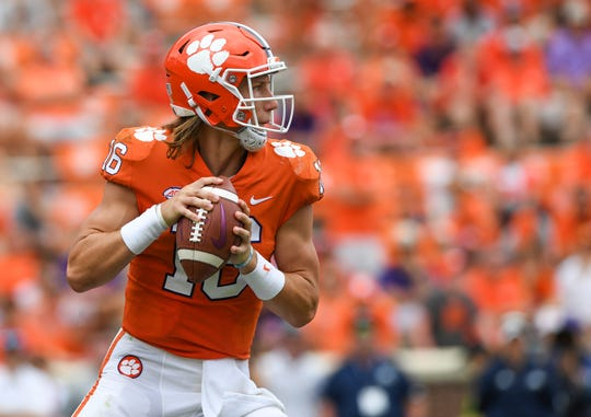 Clemson quarterback Trevor Lawrence (16) looks to pass against Georgia Southern during the 4th quarter Saturday, September 15, 2018, at Clemson's Memorial Stadium.