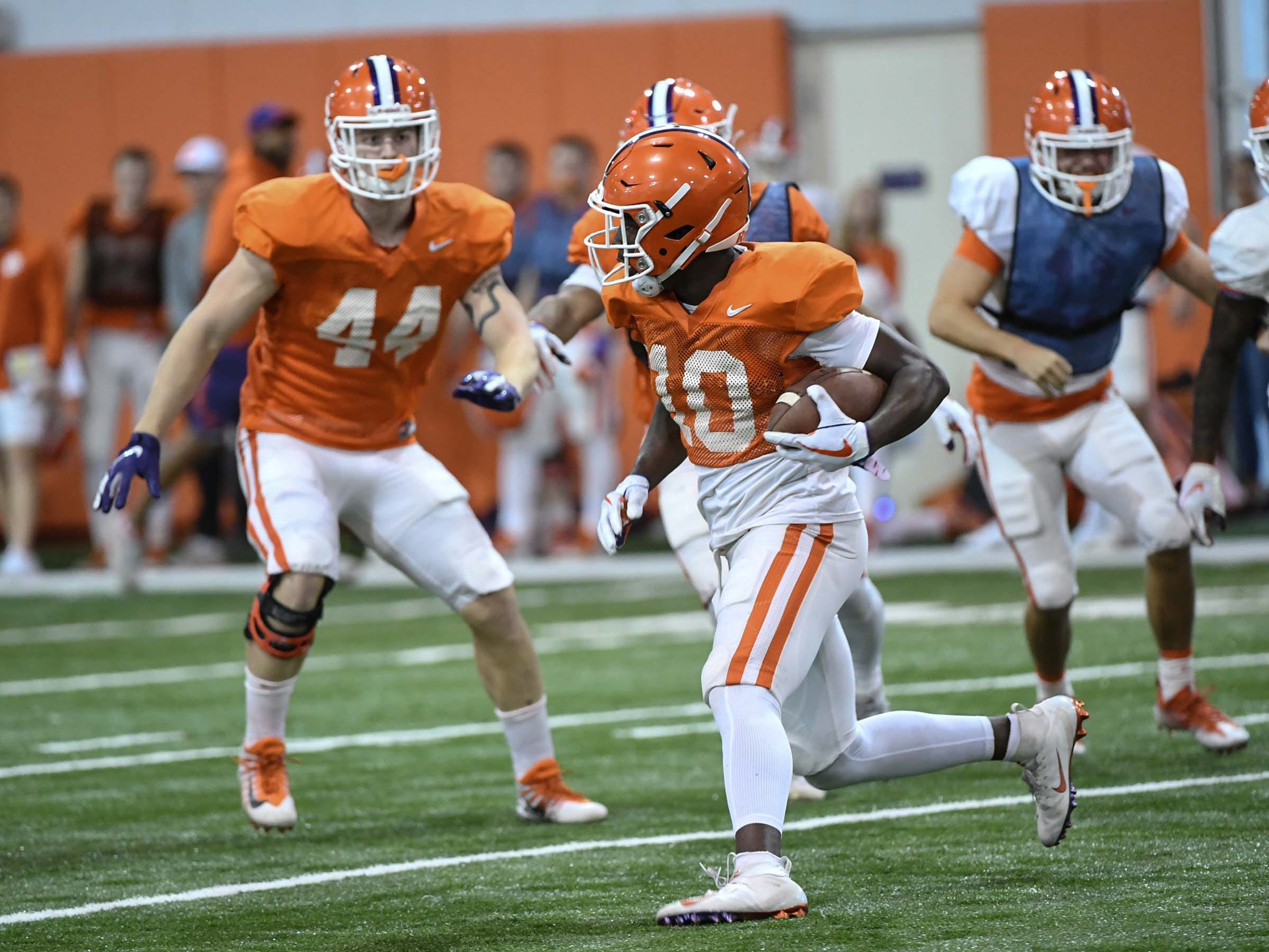 Clemson wide receiver Derion Kendrick (10) returns a kickoff during practice for the Cotton Bowl at the Poe Indoor Facility in Clemson Friday, December 14, 2018.