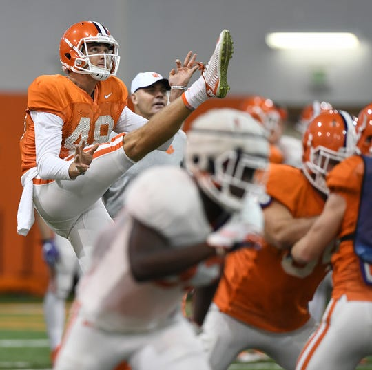 Clemson punter Will Spiers (48) punts during the Tigers Cotton Bowl practice on Friday, December 14, 2018.