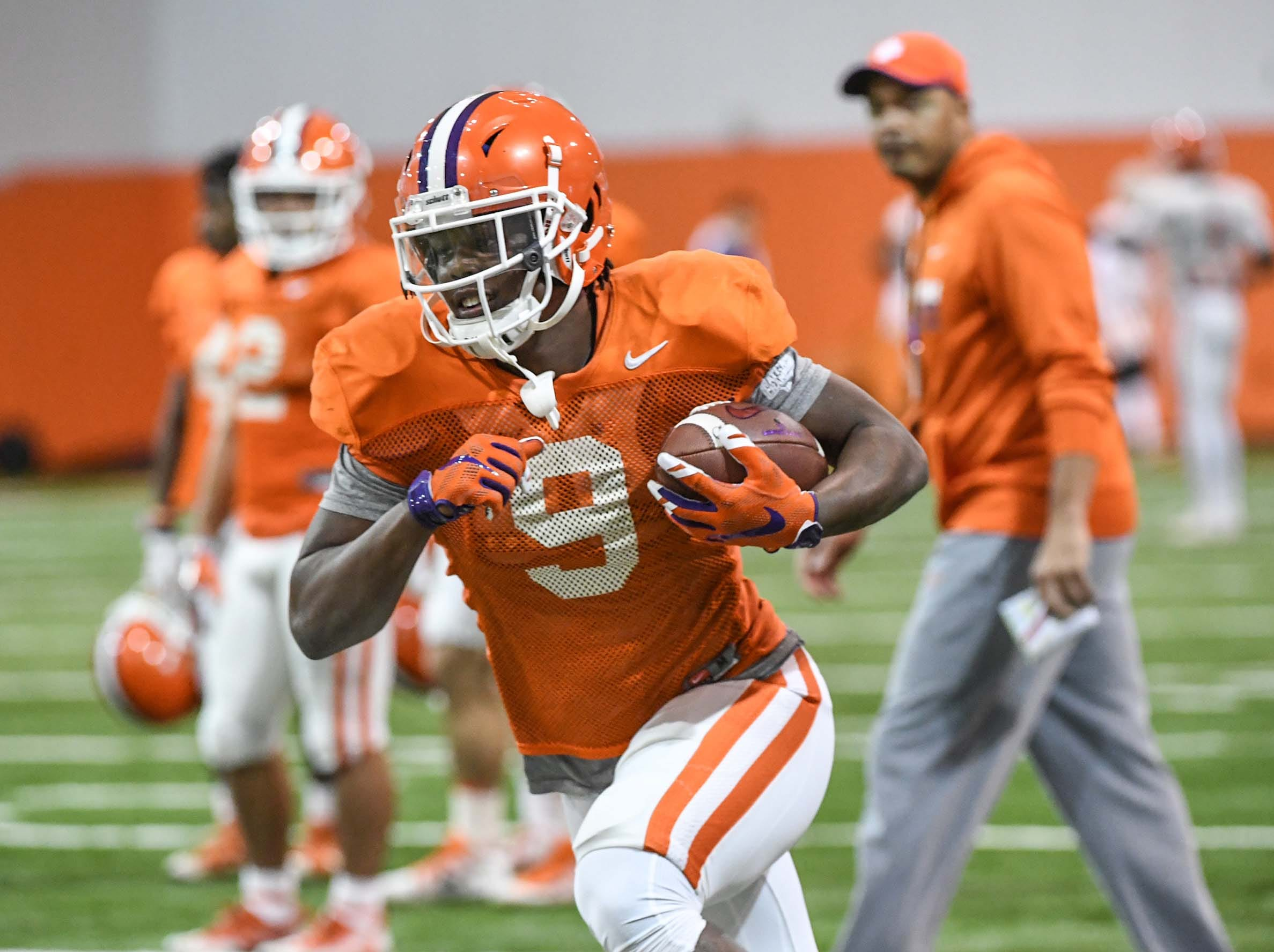 Clemson running back Travis Etienne (9) runs after a catch during practice for the Cotton Bowl at the Poe Indoor Facility in Clemson Friday, December 14, 2018.