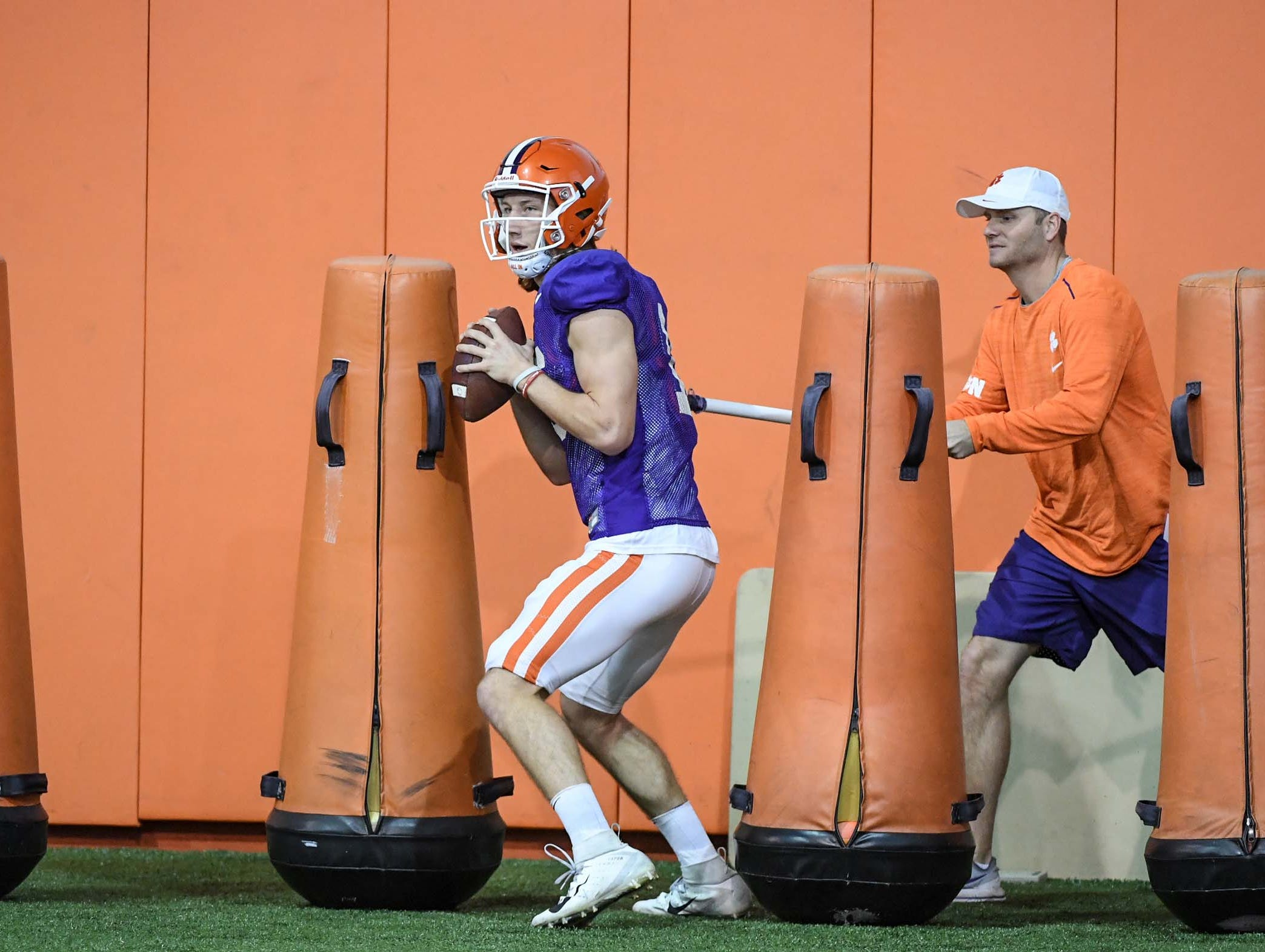 Clemson quarterbacks coach Brandon Streeter watches Clemson quarterback Trevor Lawrence (16) throw during practice for the Cotton Bowl at the Poe Indoor Facility in Clemson Friday, December 14, 2018.