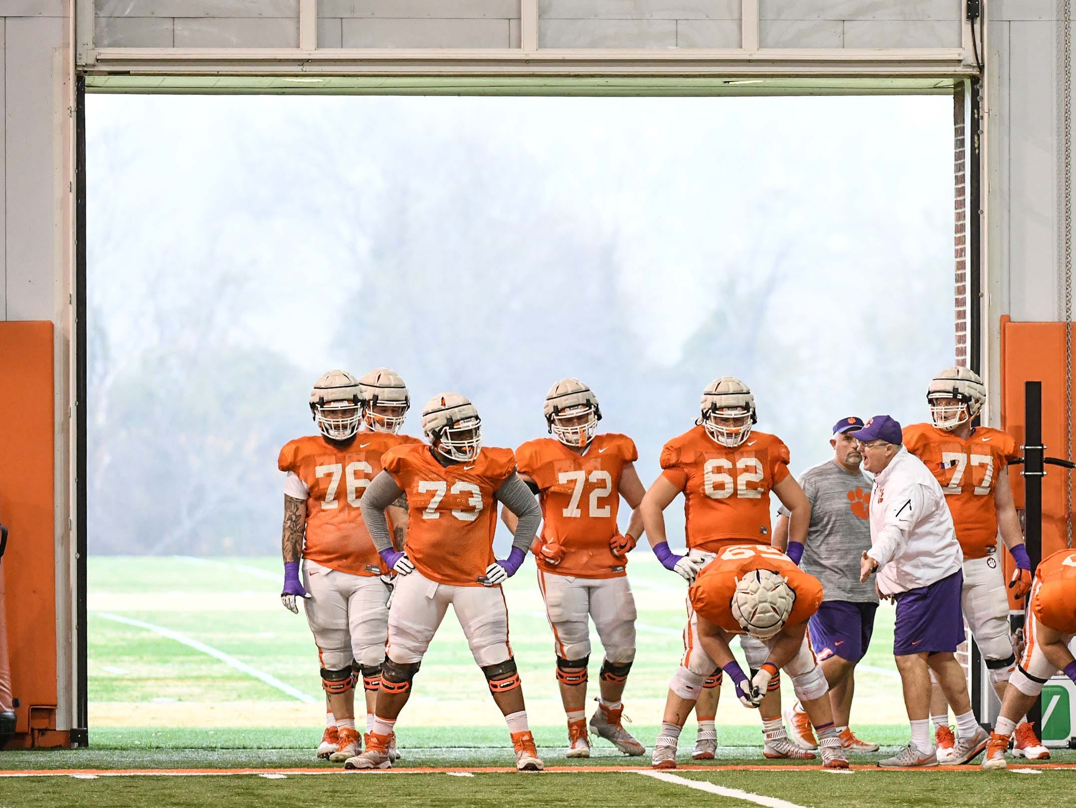 Clemson offensive linemen in a drill during practice for the Cotton Bowl at the Poe Indoor Facility in Clemson Friday, December 14, 2018.