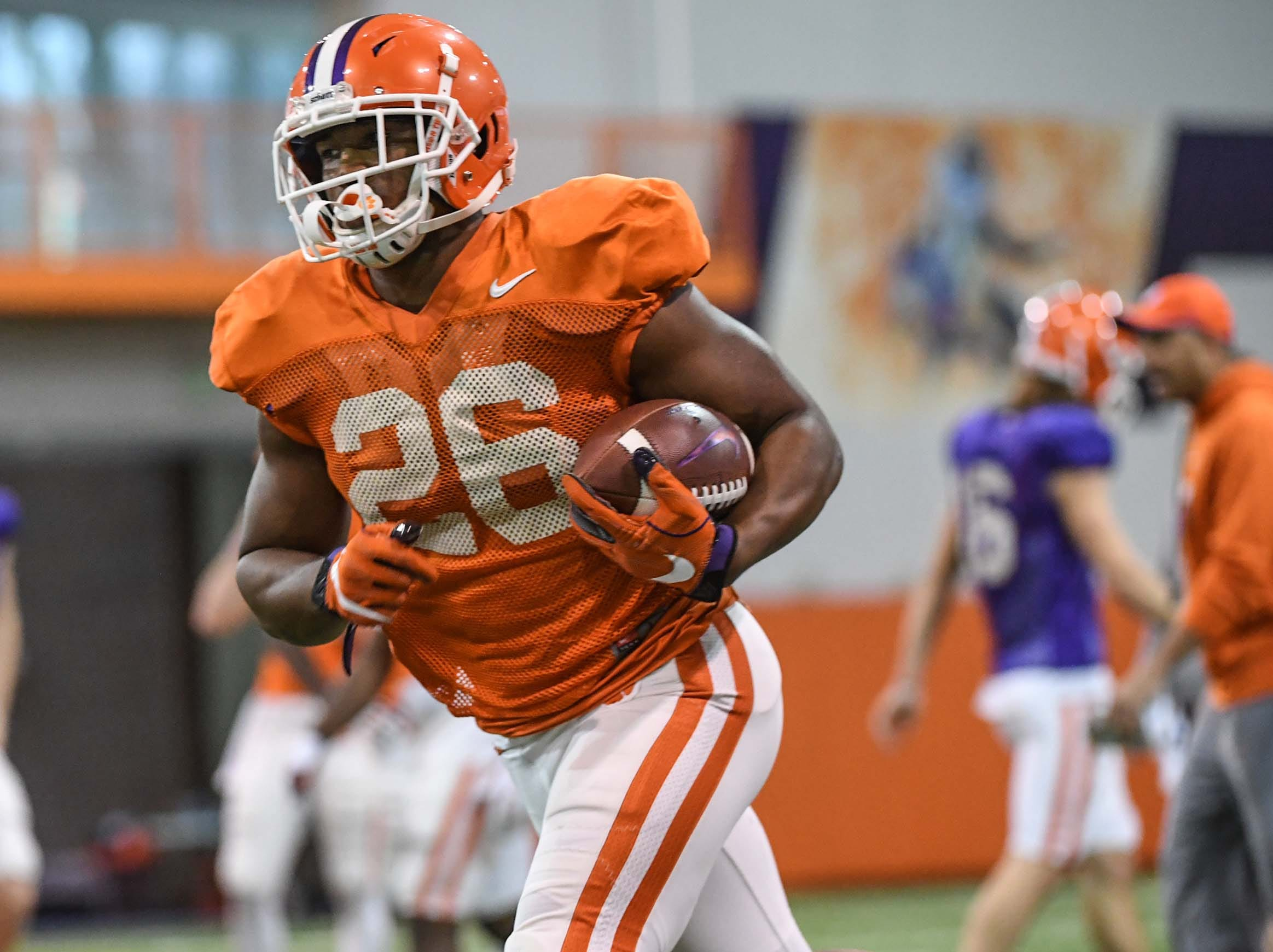 Clemson running back Adam Choice (26) runs after a catch during practice for the Cotton Bowl at the Poe Indoor Facility in Clemson Friday, December 14, 2018.