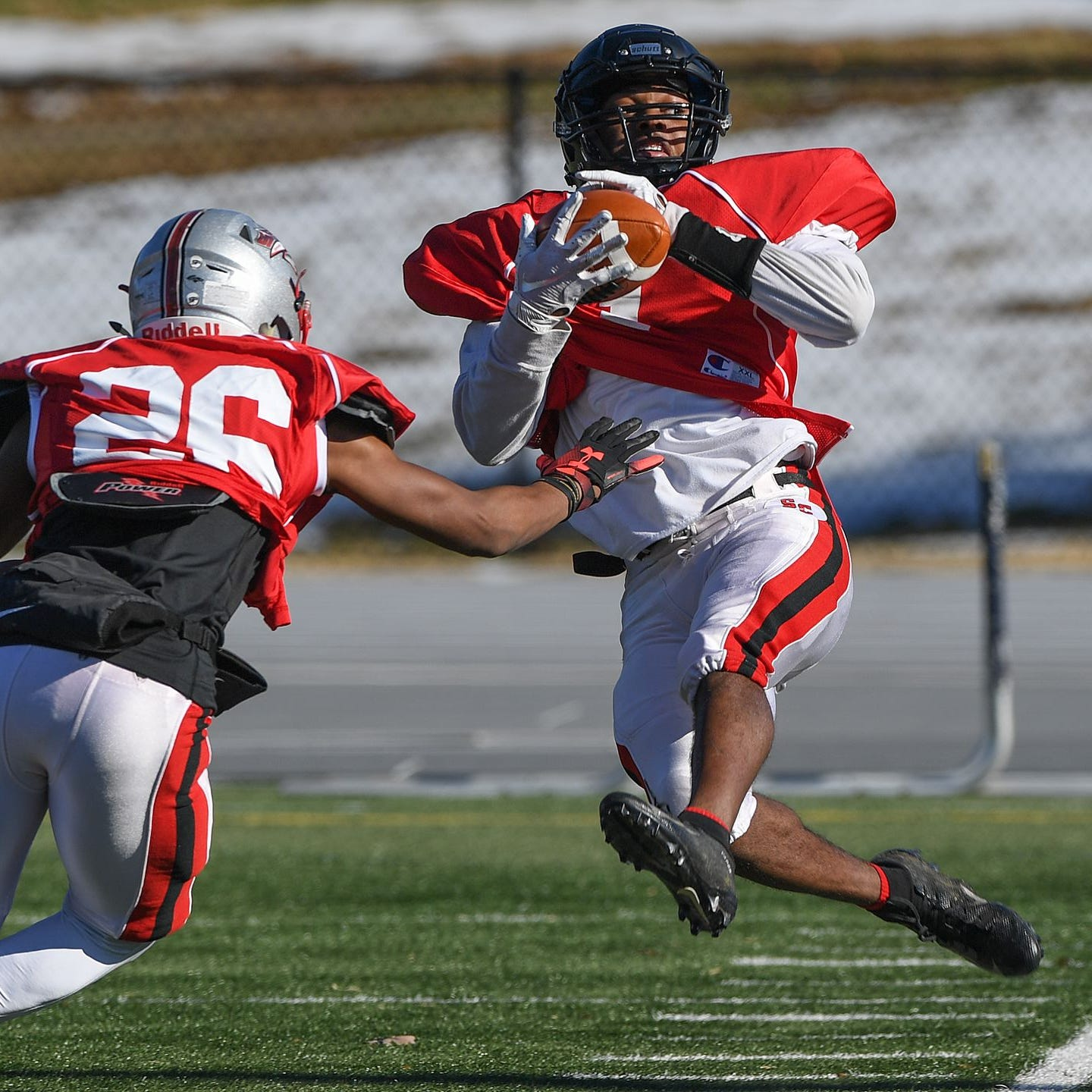 Hillcrest wide receiver Quendarius Jefferson (81) makes a reception past South Pointe defensive back Jaylen Mahoney (26) during South Carolina's Shrine Bowl practice Tuesday.