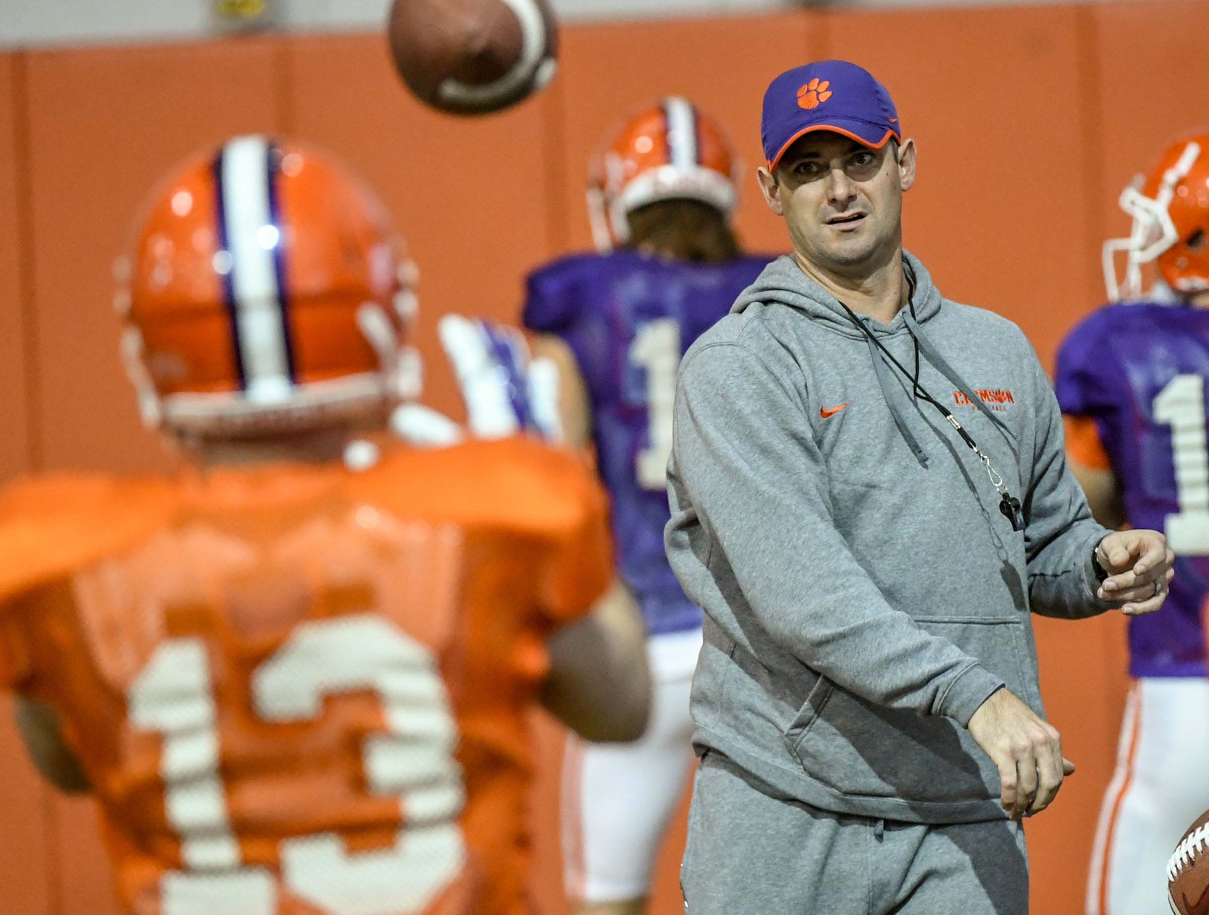 Clemson wide receiver coach Jeff Scott throws to Clemson wide receiver Hunter Renfrow (13) during practice for the Cotton Bowl at the Poe Indoor Facility in Clemson Friday, December 14, 2018.