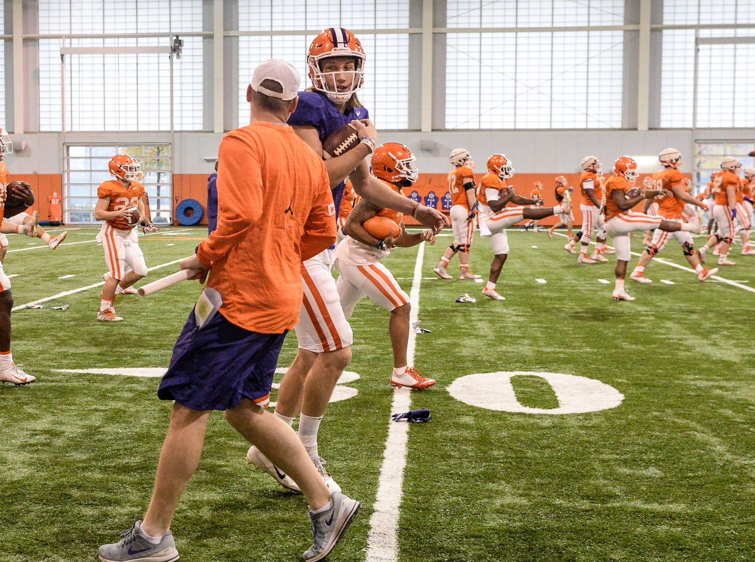 Clemson quarterback Trevor Lawrence (16) and Brandon Streeter during practice for the Cotton Bowl at the Poe Indoor Facility in Clemson Friday, December 14, 2018.
