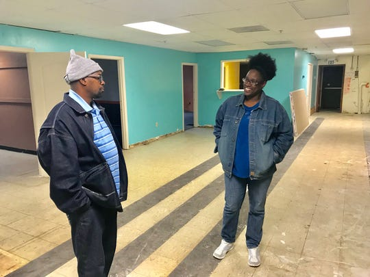 Tracy Gantt, left, and his wife Sunshine, talk about progress in preparing shelter for the homeless in Pickens County.