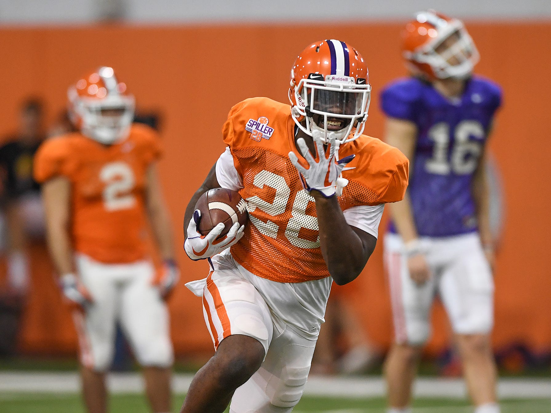 Clemson running back Tavien Feaster (28) carries the ball during the Tigers Cotton Bowl practice on Friday, December 14, 2018.