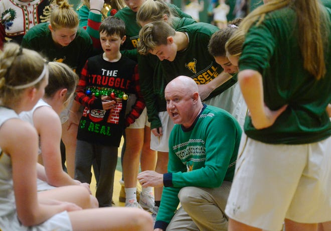 CMR Girls Basketball Coach Brian Crosby draws up a play during their game against Missoula Big Sky earlier this season at the CMR Fieldhouse.