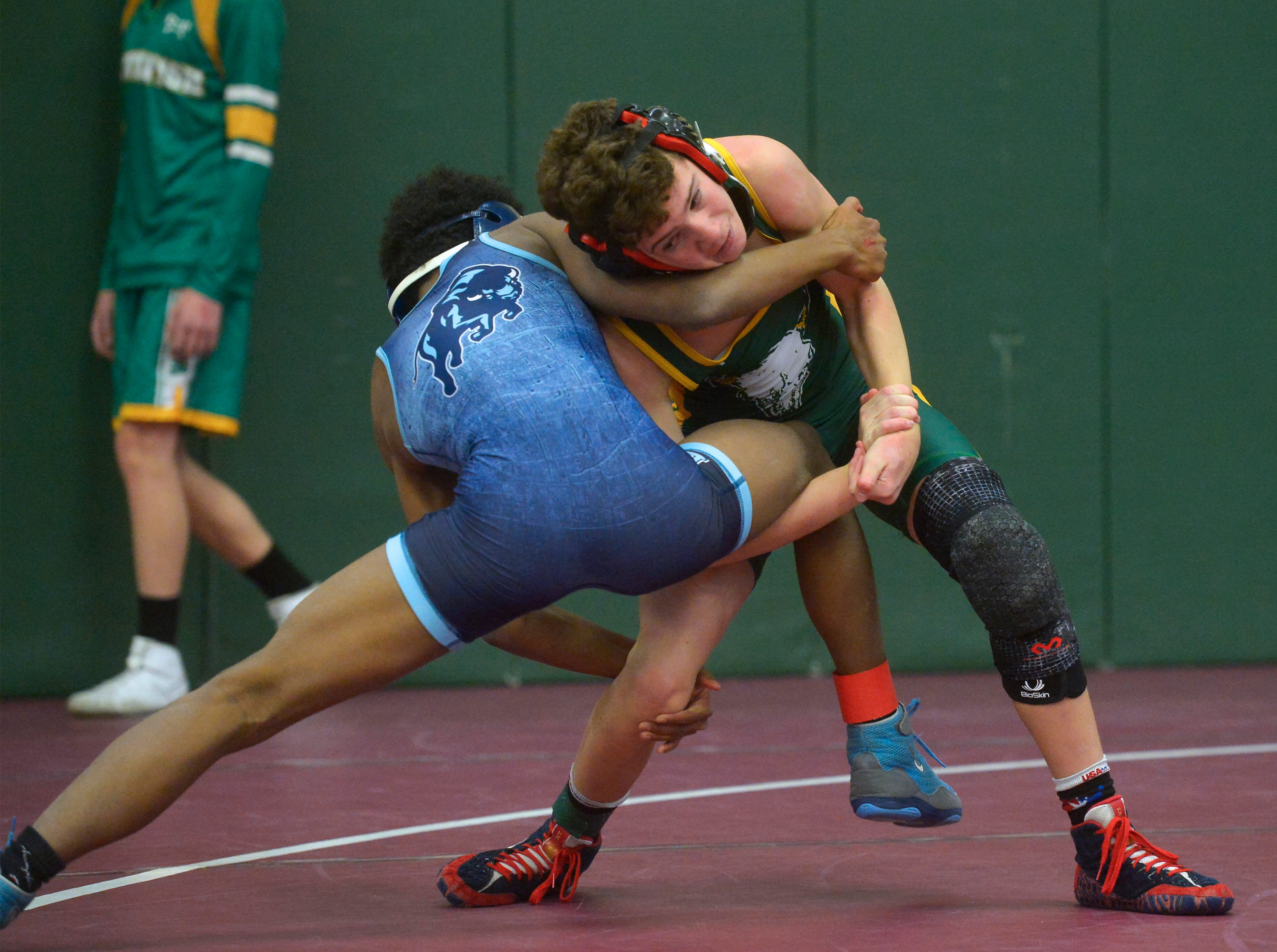 Great Falls High's Dre Coles wrestles against CMR's Colton Martello during the CMR Holiday Classic Wrestling Tournament in the CMR Fieldhouse on Friday.
