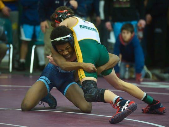 Great Falls High Dre Coles, left, wrestles Colton Martello of CMR during the Holiday Classic tournament last December. The athletes could face off again Friday night as the Bison take on the Rustlers at CMR Fieldhouse.