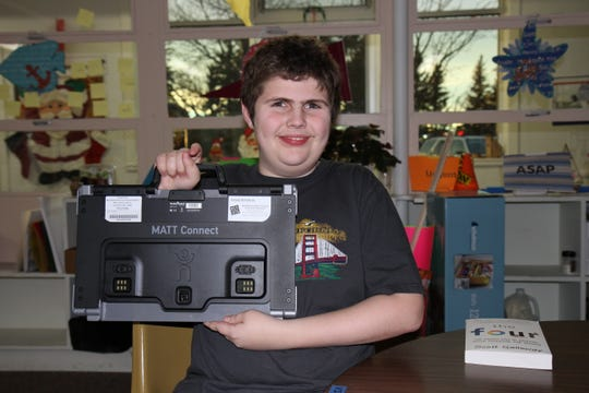 Student, Dakota Randles, with showing the portability of the Prodigi Connect 12.