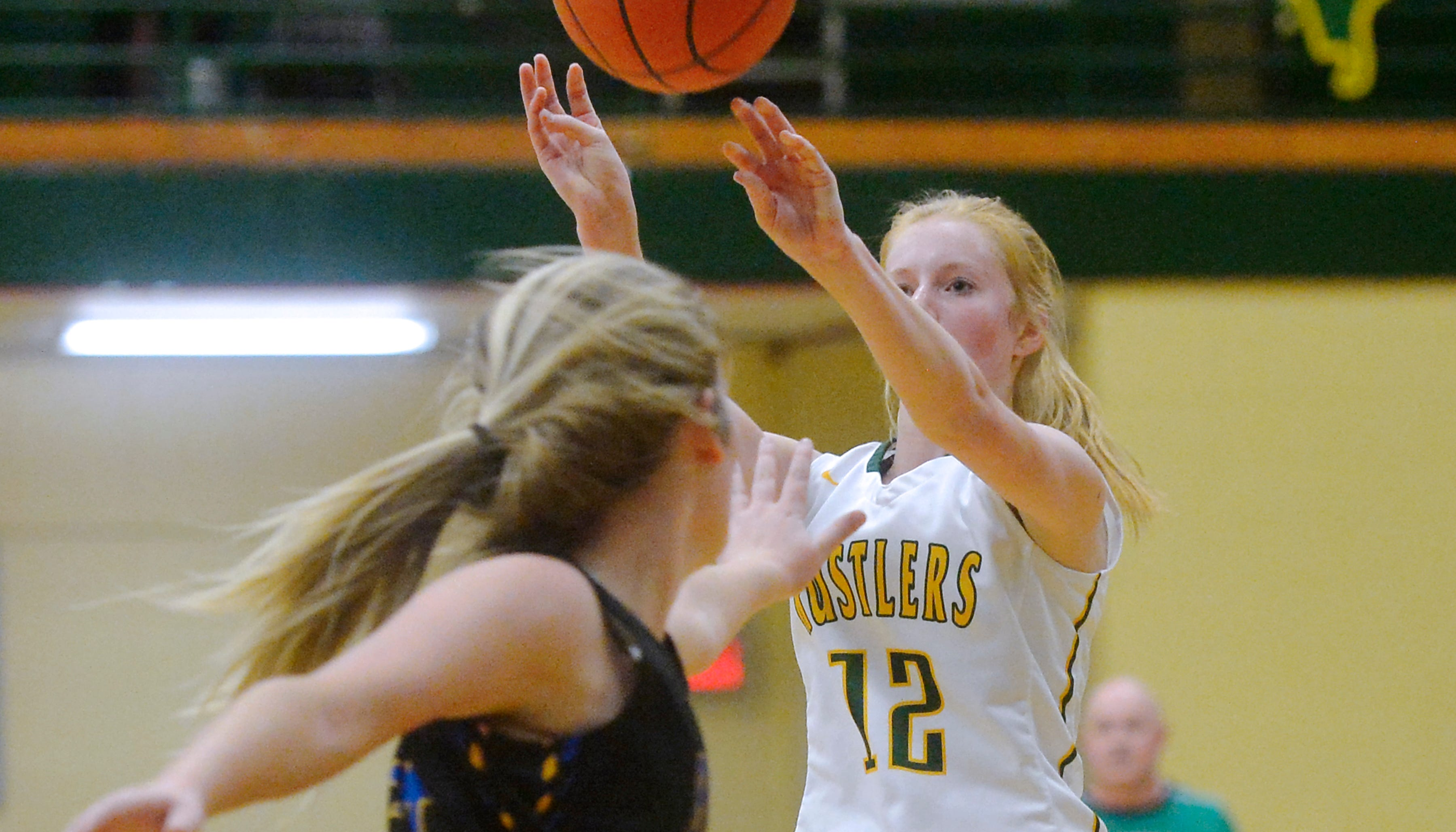 CMR's Emily Funseth shoots from the outside during Thursday evening's baskeball game against Missoula Big Sky in the CMR Fieldhouse.